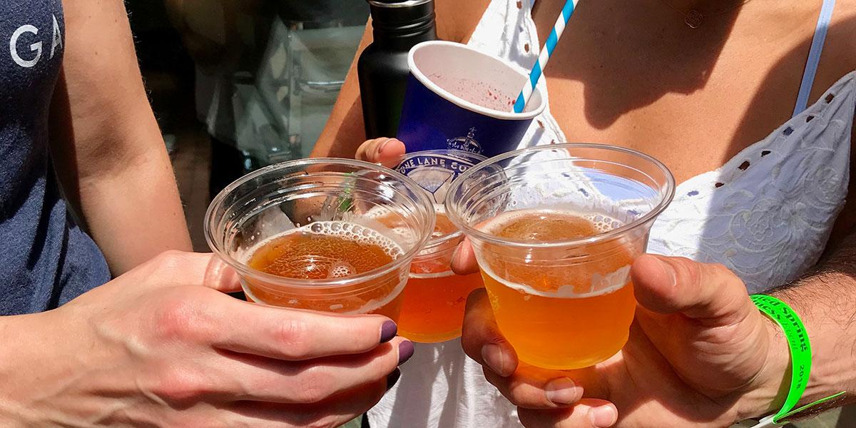 friends sharing beer, cold craft beer, bluestone lane, straw