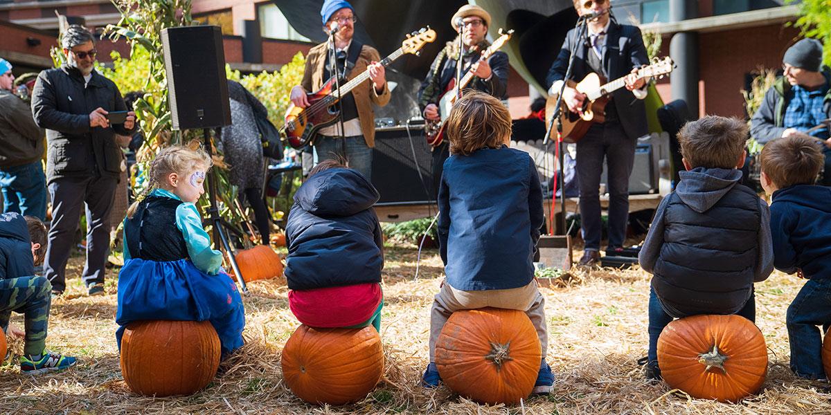 kids listening to music, kids sitting on pumpkins, pumpkin patch