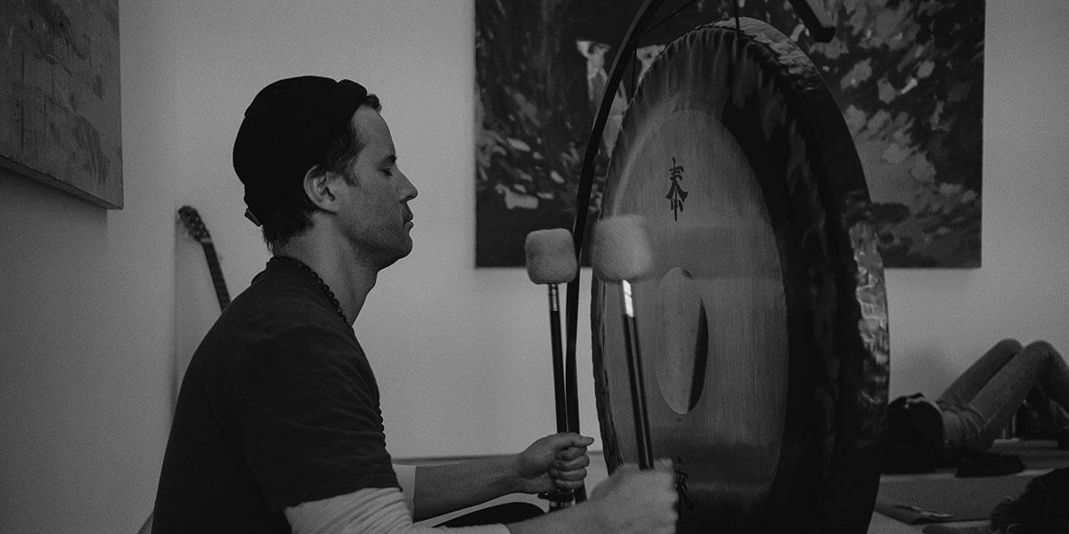 sound bath, man drumming, sound bath drum, black and white drumming
