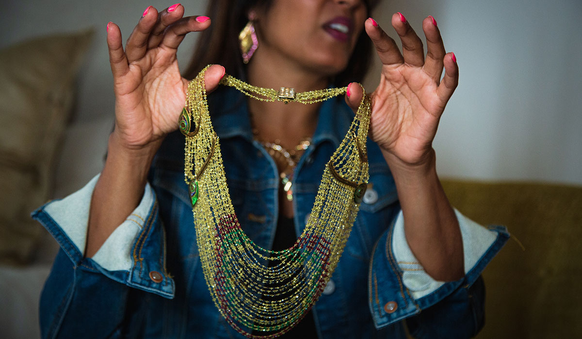 Madhuri Parson, Madhuri Parson Jewelry, Beaded Jewelry, Woman Holding Necklace