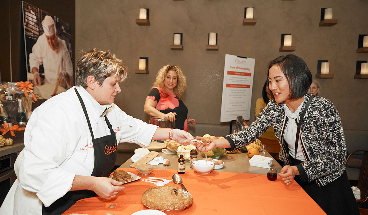 woman trying food, food demo, cooking demo, citarella thanksgiving