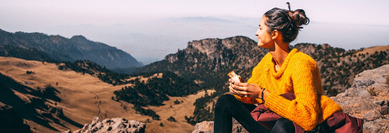 woman on a hike, woman hiking, woman atop mountain