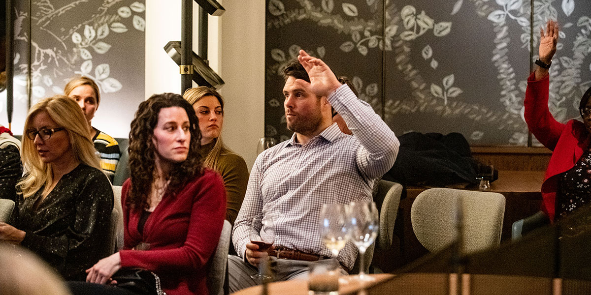 man asking question, man raising hand