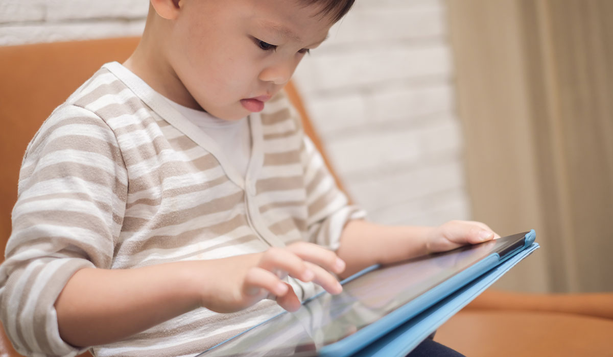 kid playing with tablet, little boy with tablet